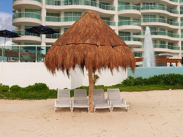 Never a problem getting a chair under a palapa at at Bay View Grand Cancun condo rentals