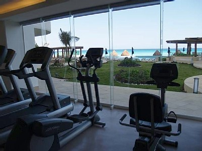 Fully equipped gym overlooking Caribbean at Bay View Grand Cancun condo rentals
