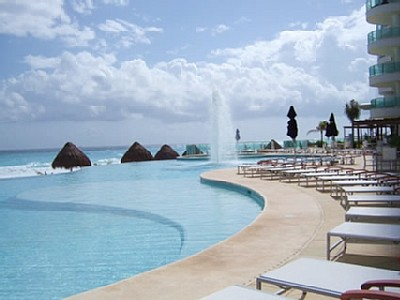Two huge oceanfront infinty pools overlooking Caribbean at Bay View Grand Cancun condo rentals