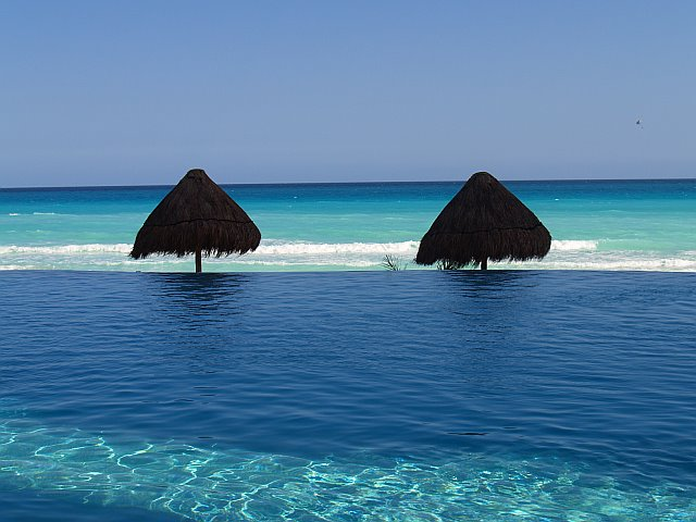 Wow, where does the pool end and ocean start at Bay View Grand Cancun condo rentals
