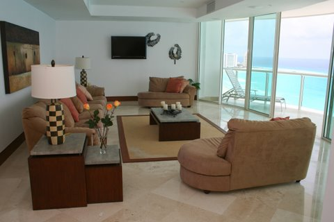 Another view of the extra large great room with contemporary furniture, ocean view