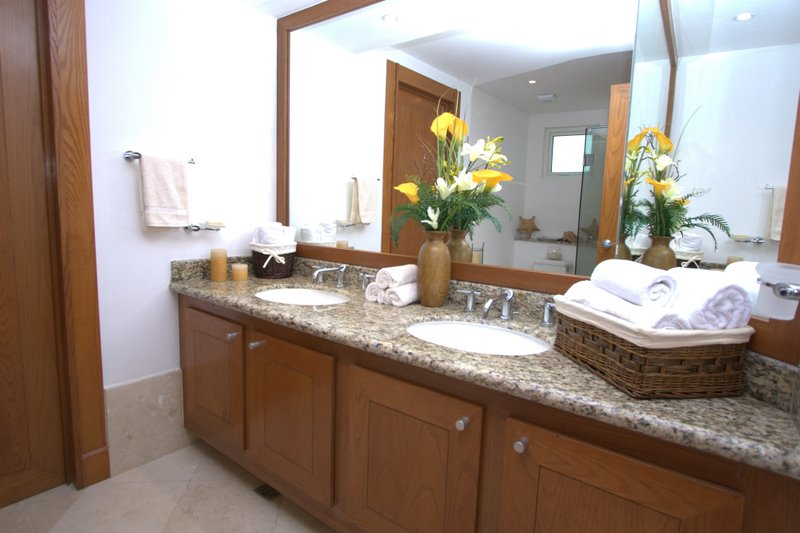 ultra luxury bathroom with sit down shower, granite counters, and fine porcelain tiles