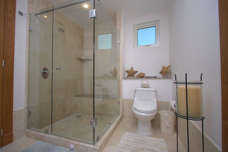 contemporary bath huge shower with frameless doors and fine porcelian tile