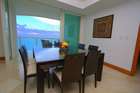 Another view of the extra large great room with contemporary furniture, ocean views