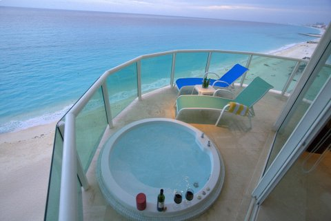 Private master bedroom oceanfront  patio with jacquzzi and views of Caribbean Sea