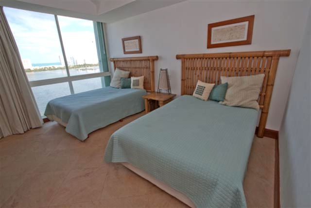 Guest suite 3 with two full size beds and lagoon view