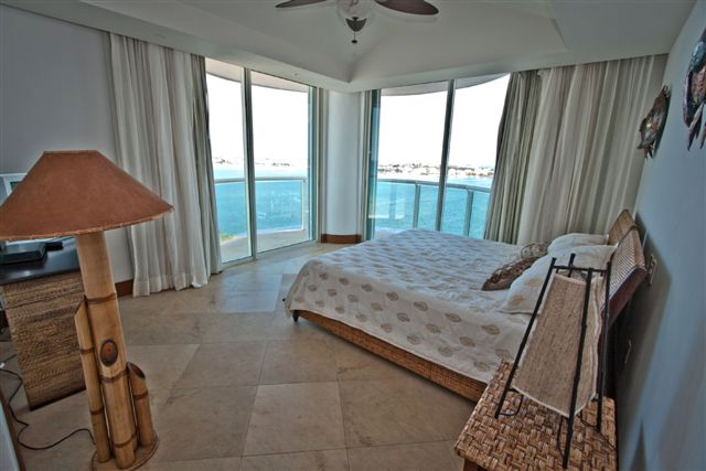 Guest suite 2 with attached full bath and lagoon view