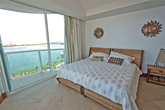 Guest Suite 2 with King Size Bed full bath and lagoon view terrace