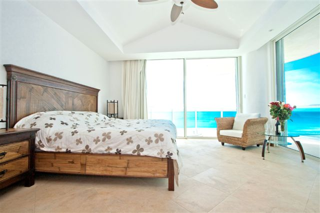 Master Bedroom with full bath and access to ocean view terrace