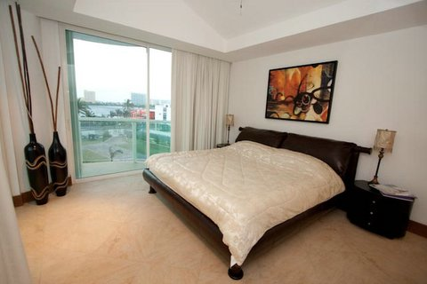 Guest Suite 2 with full bath and access to lagoon view terrace