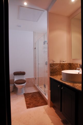 ultra luxury bathroom with sit down shower, granite conters, and fine porcelain tiles