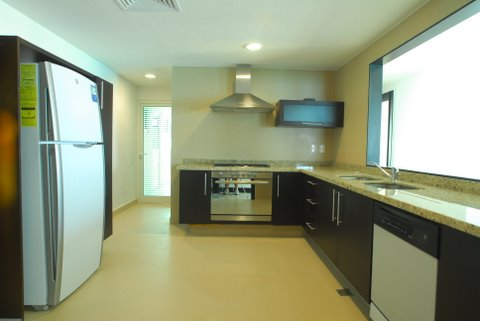 ultra luxury kitchen open to great room with granite counters, and fine porcelain tiles