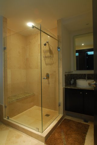 contemporary bath huge shower with frameless doors and fine porcelian tile