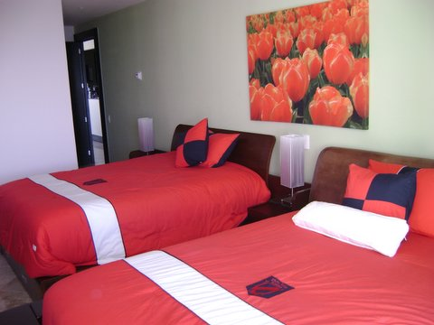 Guest suite 3 with city view terrace, full bath, walk in closet and 32 inch lcd tv