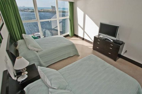Bedroom #2 offers 2 full size beds, attached full bath, Lagoon views