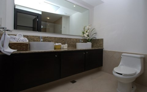 ultra luxury bathroom with sit down shower, granite towers, and fine porcelain tiles