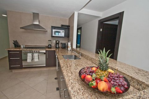 contemporary kitchen with open view to great room, and cancun ocean and beach