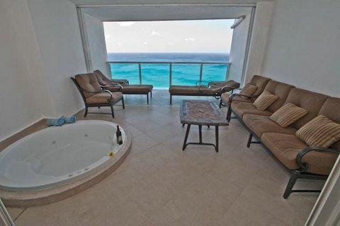 Relax on the luxurious patio furniture and feel the ocean breeze