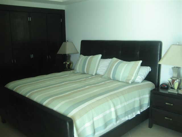 Guest suite 2 with ocean view terrace, full bath, walk in closet and 32 inch lcd tv