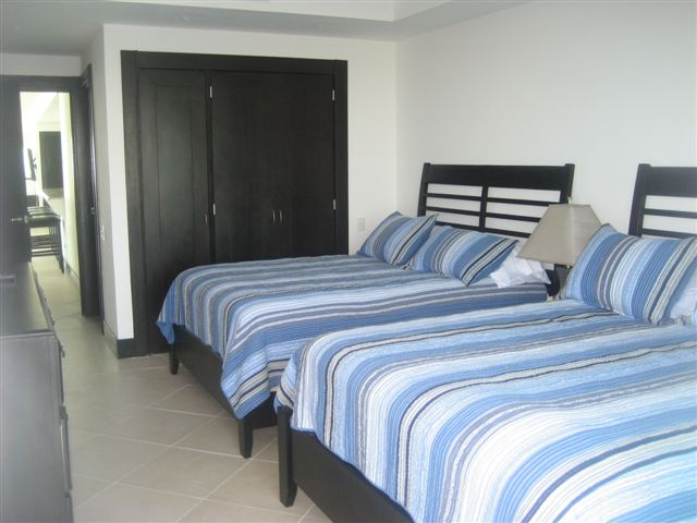 Guest suite 3 with Ocean and Lagoon view terrace, full bath, walk in closet and 32 inch lcd tv