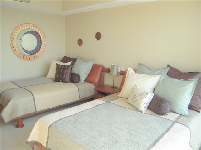 Bedroom #2 offers 2 full size beds, and attached bath, walk in closet, and 32 inch lcd tv