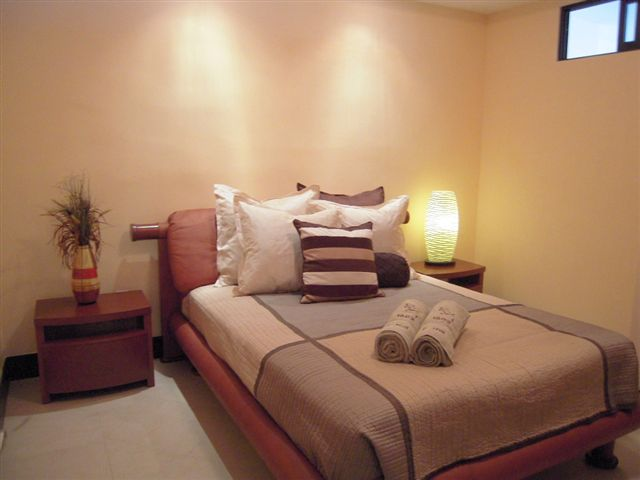 Bedroom 3 offer a queen size bed, sliding mirroed door closet with built in drawers and shelves, and 32 inch lcd tv