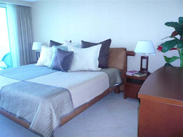 master bedroom with lagoon and city view terrace, full bath, walk in closet and 32 inch lcd tv