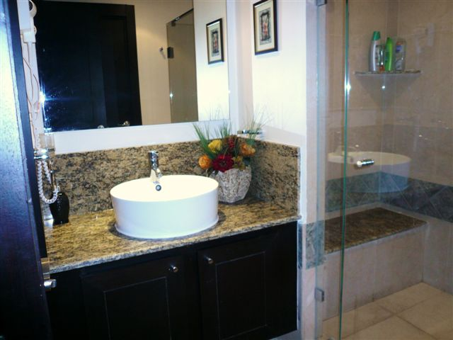 contemporary master bath with double basins, huge shower with frameless doors and fine porcelian tile